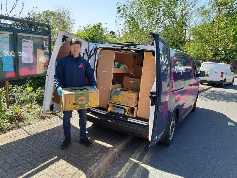 An image of an oes volunteer by their van