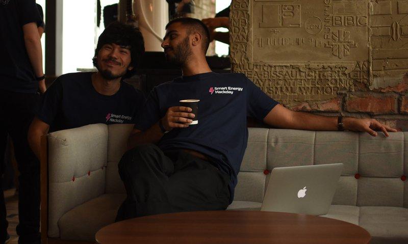Photo of Suraj and Karim chatting at the office