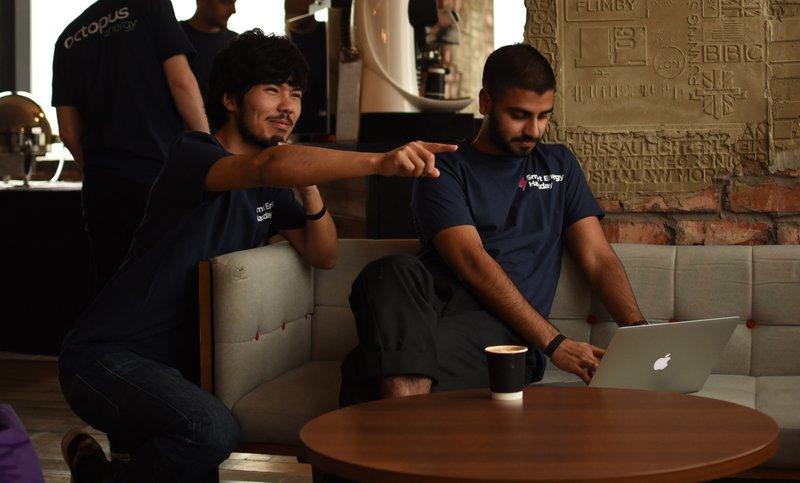 Photo of Karim pointing something out to Suraj
