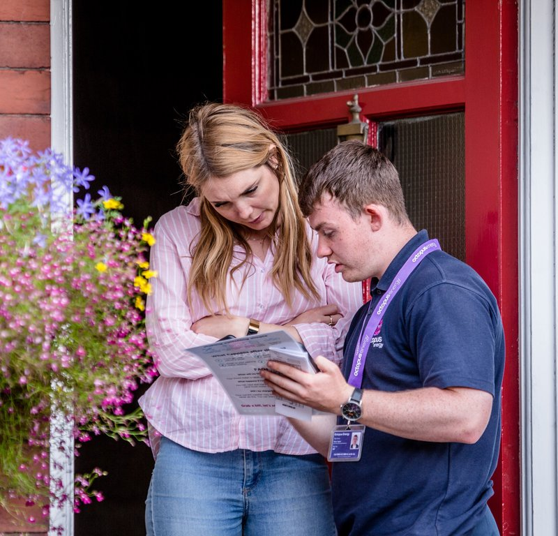 A door-to-door representative helping a customer