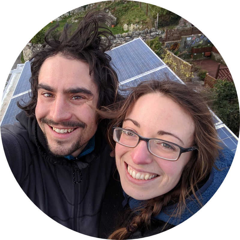 An image of Glyn and Amy in front of their solar panels