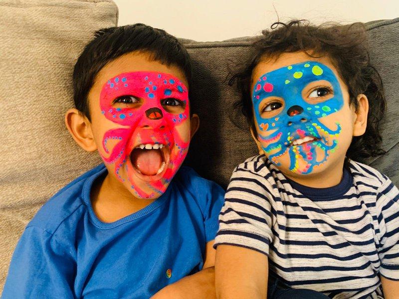 Two Kids Wearing Octopus Facepaint