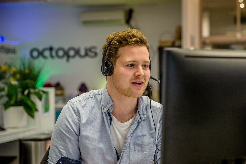 An image of one of our ops team members answering the phone
