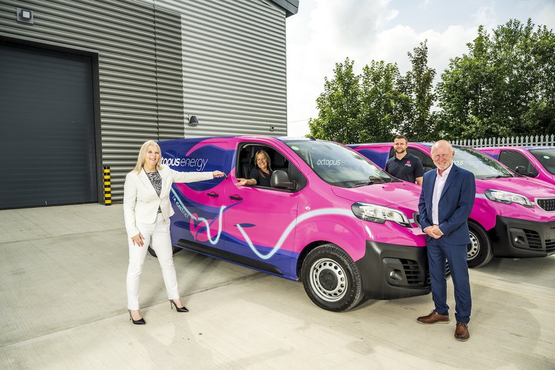 Octopus Energy Engineers receiving keys to Peugeot E-Expert vans from Peugeot reps