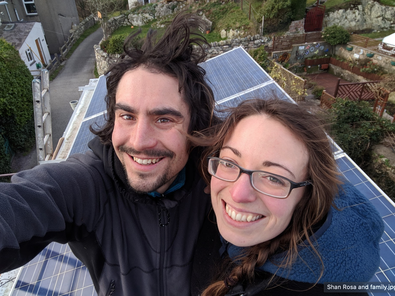 A photo of Glyn and Amy with their home solar panels