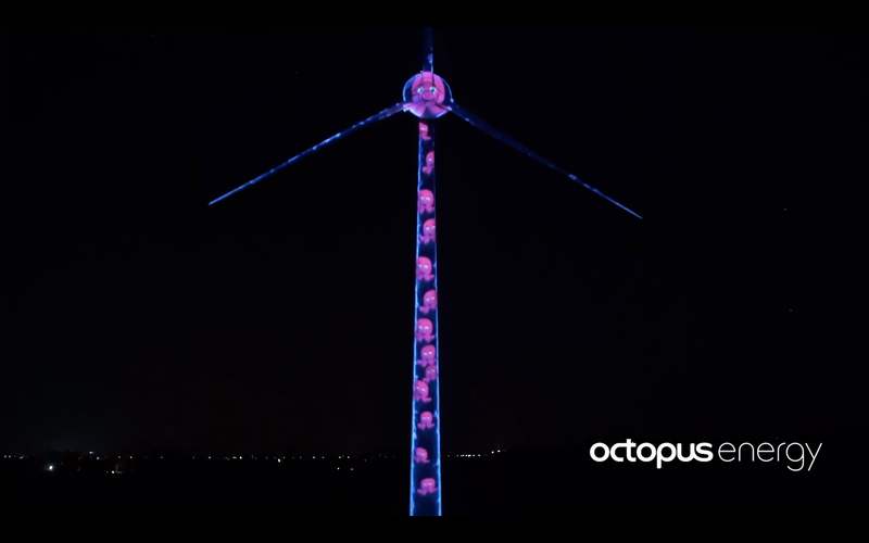 A photo of a pink octopus light display projected on our wind turbine