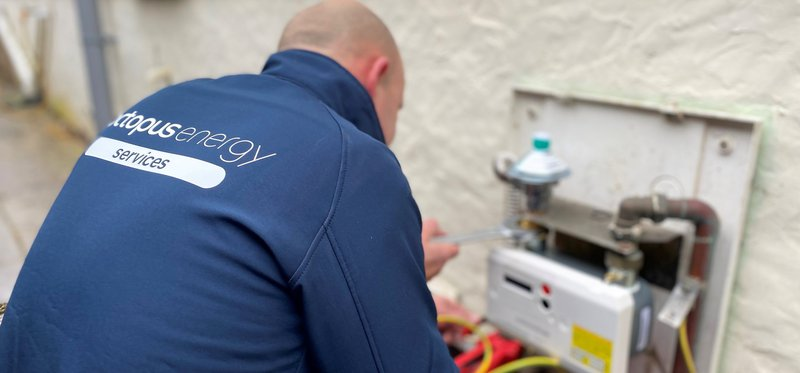 An Octopus Energy Services engineer installing a smart meter