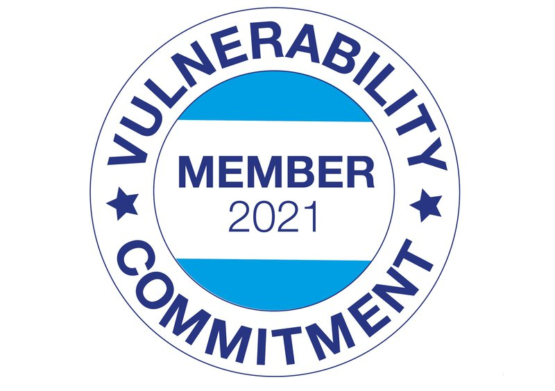An image of the Vulnerability Commitment logo