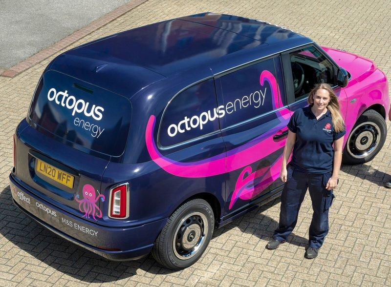 An image of zoe next to her van