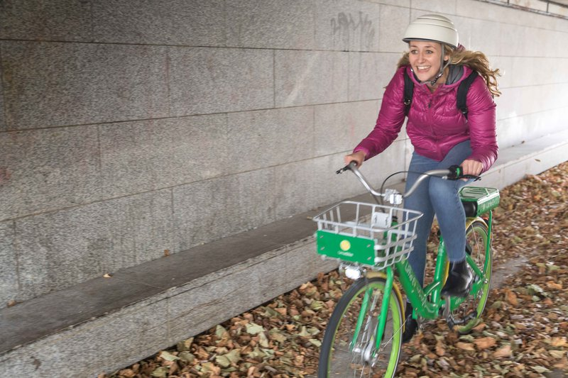 An Image of Florence Milner riding a lime bike through a tunnel