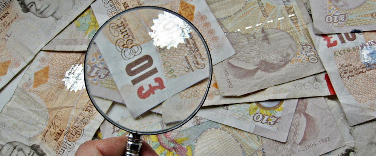 money notes magnifying glass